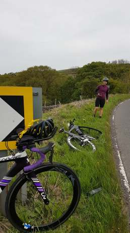 The signpost and where The Short One landed on the verge.......
